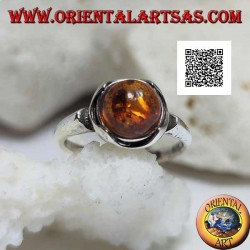 Silver ring with round cabochon amber surrounded by semicircles on a smooth setting