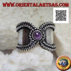 Wide band ring in silver with interweaving on the sides and round amethyst to close