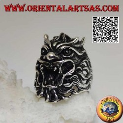Silver ring in the shape of the face of an evil demon