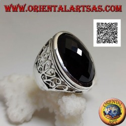 Silver ring with large oval faceted onyx and wavy openwork decoration on the sides