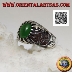 Silver ring with cabochon oval green agate set with claws and embossed floral decorations on the sides