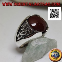 Silver ring with round carnelian and motif in the triangle in bas-relief on the sides