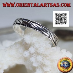 Silver band ring with engraved bundles of oblique parallel lines