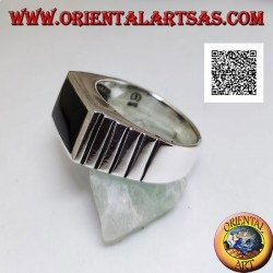 Silver ring with horizontal rectangular onyx flush with the edge and vertical incisions on the sides