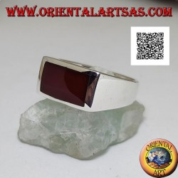 Silver ring with horizontal rectangular carnelian flush with the edge on a smooth setting