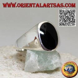 Silver ring with flat oval onyx flush with the edge