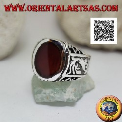 Silver ring with oval carnelian flush with the edge with gothic decorations in bas-relief on the sides