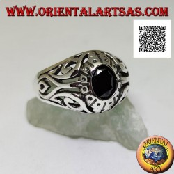 Silver ring with faceted oval onyx and openwork floral decoration on the sides