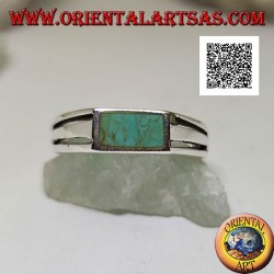 Silver ring with rectangular turquoise flush with the edge and two horizontal perforated lines on the sides