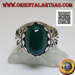Silver ring with cabochon oval green agate set with openwork decoration on the sides