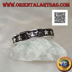 Silver ring with a smooth bas-relief row of stars