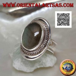 Silver ring with oval cabochon labradorite surrounded by intertwining on a smooth shield (20b)