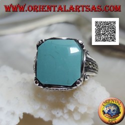 Silver ring with square cabochon turquoise in wavy frame and marcasite around and on the sides