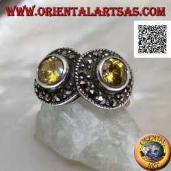 Silver ring with two round yellow topazes in two circles studded with marcasite intersecting each other