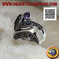 Silver ring of abstract shape in futuristic style with parts of marcasite and round amethyst
