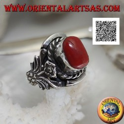 Silver ring with oval Tibetan antique coral with interweaving and integral flower on the sides