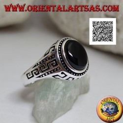 Silver ring with oval cabochon onyx surrounded by disks and S engraved on the sides