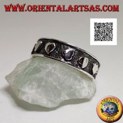 Silver ring with smooth hearts in randomly oriented bas-relief