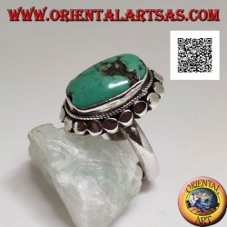 Silver ring with antique Tibetan turquoise oval surrounded by studs (12)