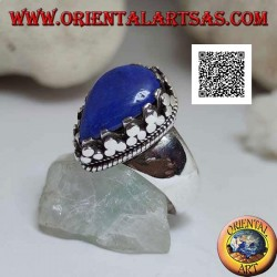 Silver ring with a large lapis lazuli drop surrounded by a trio of discs and weaving