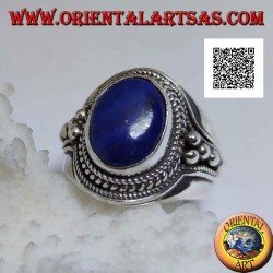 Silver ring with oval lapis lazuli surrounded by weaving and balls on the sides