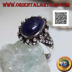 Silver ring with oval lapis lazuli with triangular decoration of balls around and on the sides