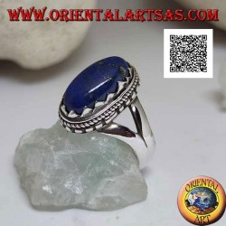 Silver ring with oval lapis lazuli set with triangles and with interweaving around