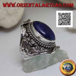 Silver ring with oval lapis lazuli on Nepalese setting and ethnic floral decoration in high relief