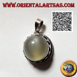 Silver pendant with round cabochon moonstone surrounded by interlacing and trio of discs