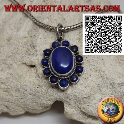 Silver flower pendant with oval cabochon lapis lazuli in the center and round petals