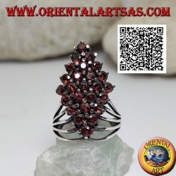 Silver ring with a rhombus of round garnets set at the bottom hooked by four wires