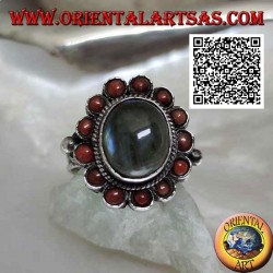 Silver flower ring with oval cabochon labradorite surrounded by Tibetan corals