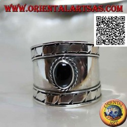 Wide band silver ring with oval onyx and oblique engravings on the sides, Bali