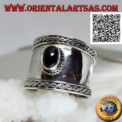 Wide band silver ring with oval onyx and intertwining on the sides, Bali