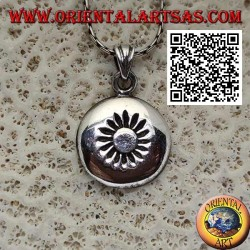 Silver pendant, rounded rounded medal with sun engraved in the center