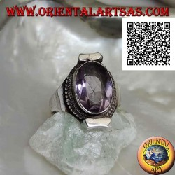Silver ring with natural oval faceted amethyst surrounded by weaving on Nepalese setting