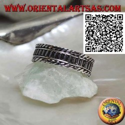 Silver ring with vertical segments between rolled cords