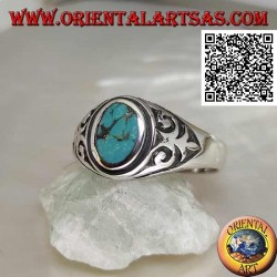 Silver ring with natural oval turquoise with imperial lily in bas-relief on the sides