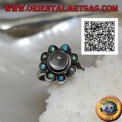 Bague en argent marguerite avec une pierre de lune cabochon ronde entourée de turquoise
