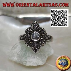 Silver ring with round aquamarine on a six-petal flower studded with marcasite