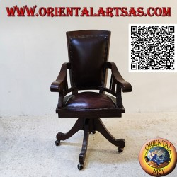 Office armchair in teak wood with upholstered seat and back upholstered in leather and wheels