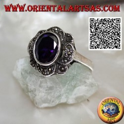 Silver ring with oval amethyst-colored zircon surrounded by wavy bands of marcasite