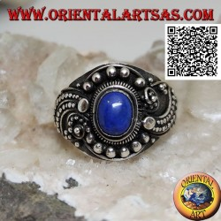 Silver ring with oval lapis lazuli and wavy beaded ethnic decoration