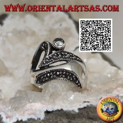 Silver ring of abstract shape in futuristic style with parts of marcasite and round aquamarine