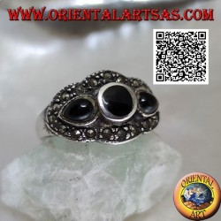 Silver ring with round onyx between onyx drops surrounded by marcasite