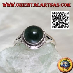 Silver ring with round cabochon-shaped aventurine surrounded by interweaving