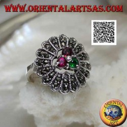 Silver flower ring with trio of central ruby and emerald colored zircons and long marcasite petals