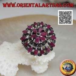 Silver ring in the shape of a large rose window with natural shuttle rubies and marcasite alternating in circles