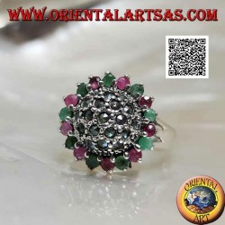 Silver flower ring with a domed center studded with marcasite surrounded by natural round rubies and emeralds
