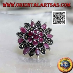 Silver ring with flowers on various levels with round and shuttle natural rubies and with marcasite